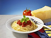 Spaghetti bolognese, tomato and Parmesan behind