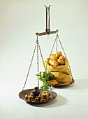 Hanging scales with weights and sack of potatoes