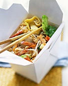 Nasi goreng with chicken, shrimps, pancake strips,take-away box