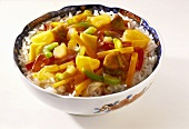 Sweet and sour meat and vegetable stir-fry on rice