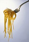 Spaghetti aglio e olio with Parmesan on fork