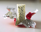 A piece of Roquefort on plastic packaging
