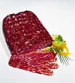 Spianata (hard cured sausage), slices cut