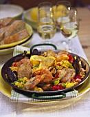 Classic paella in paella pan on laid table