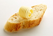 Slice of baguette with a butter curl