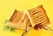 Puff pastries with spicy mince and bean filling