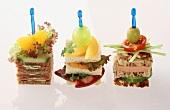 Three sandwich snacks on cocktail sticks