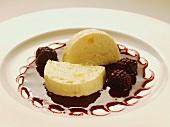 Pineapple ice cream with blackberry sauce