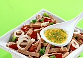 Sausage salad with peppers, onions and dressing