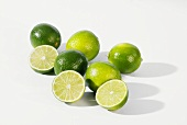 Several limes, whole and cut open