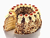 Cream sponge cake with chocolate sprinkles, a piece cut