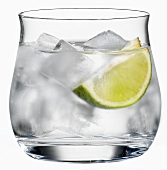 A glass of water with ice cube and a wedge of lime