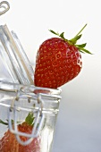 Fresh strawberries and a preserving jar