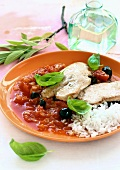 Turkey breast in olive and tomato sauce with rice