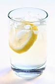Mineral water with ice and a slice of lemon