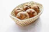 A bread basket with five bread rolls