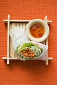 Vietnamese rice paper rolls with vegetables and spicy dip