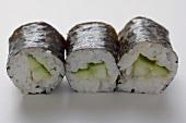 Three maki sushi with cucumber