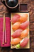 Nigiri sushi with tuna and salmon on sushi board