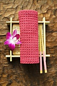Table accessories: hand towel, chopsticks, bamboo mat & orchid