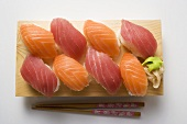 Nigiri sushi with tuna and salmon on sushi board