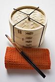 Hand towel, chopsticks and bamboo steamer