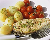 Salmon steak with potatoes and roasted tomatoes