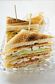Club sandwiches with chicken breast, crisps behind