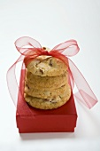 Biscuits with red bow on gift box