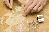 Cutting out star-shaped biscuit