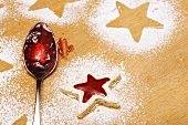 Star-shaped jam biscuit and spoon with jam