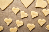 Cut-out biscuits on baking parchment