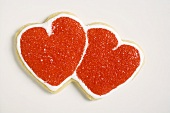 Double heart-shaped biscuit decorated with red sugar
