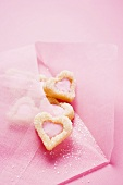 Pink envelope with heart-shaped biscuits