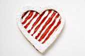 Heart-shaped biscuit with red and white icing