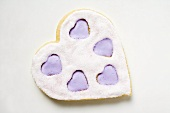 Heart-shaped biscuit with lilac and white icing