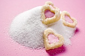 Heart-shaped biscuits on granulated sugar
