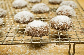 Hazelnut biscuits with grated coconut on cake rack