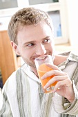 Young man drinking juice out of a glass