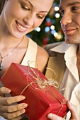 Young couple with Christmas gift