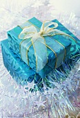Wrapped gifts, one with bow