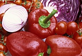 Red peppers, tomatoes, red cabbage, red onions
