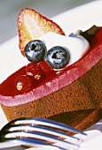 Small cake topped with berry mousse
