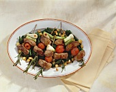 Lamb fillet and vegetables on rosemary skewers