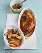 Duck leg with sultanas, apples and onions