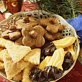 Bowl of chocolate nut biscuits, cinnamon triangles & sweet 'paws'