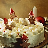 Cream cake for Christmas decorated with gingerbread figures