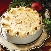 Nut cake, fir branches behind