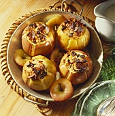 Four baked apples with raisin and almond stuffing
