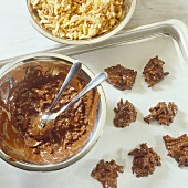 Chocolate almond clusters and ingredients on baking tray